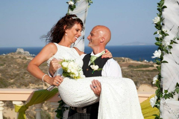 The bride and groom after their wedding on the terrace at The Tower House villa in Kos