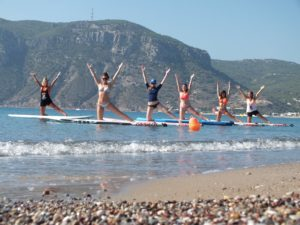 StandUpPaddle board yoga is fun and easy and included in the price of the holiday