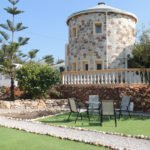 The majestic Tower, representing a traditional windmill, as seen from the garden at The Tower House in Kos