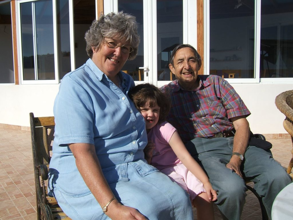 Grandaughter enjoys cuddles with Nanna and Grandad on the terrace at The Tower House